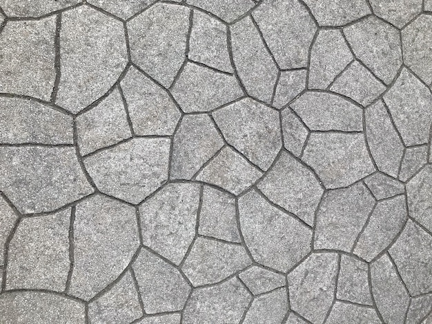 Gray weathered stone paving walking way surface background.