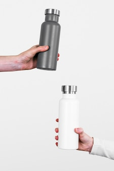 Gray and white water bottles