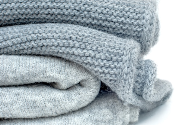 Gray winter scarves stacked