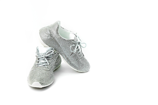 Gray with rhinestones sports shoes on white isolated background