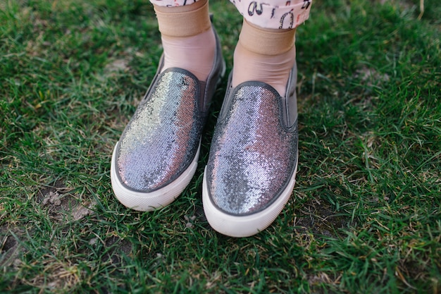 Gray women's slippers with sparkles. slip on feet. shiny shoes