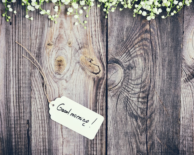 Gray wood background with paper tag