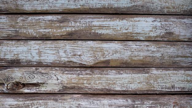 오래 된 페인트 판자로 회색 나무 배경