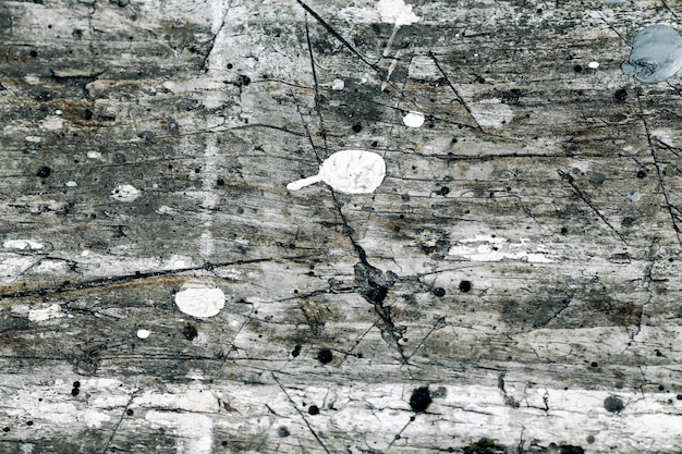 Gray wooden scratched grunge texture background with nails and cracked gray white paint drops with wood vintage structure.
