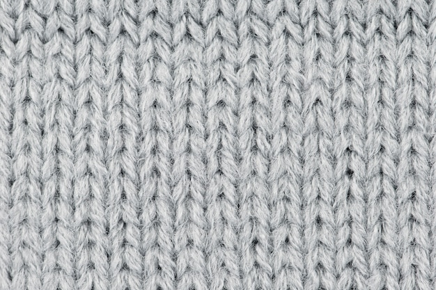 Gray wool knitted background.