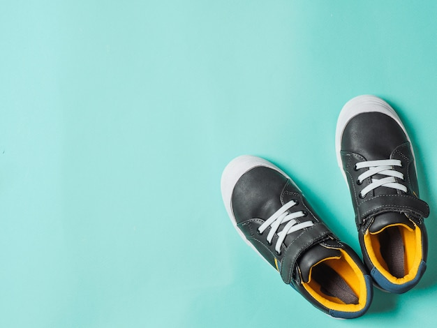 Gray and yellow sneakers on blue
