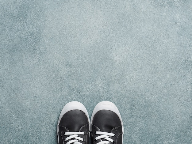 Gray and yellow sneakers on gray background