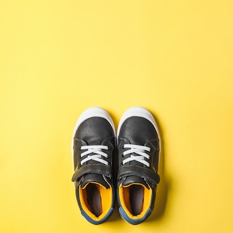 Gray and yellow sneakers on yellow