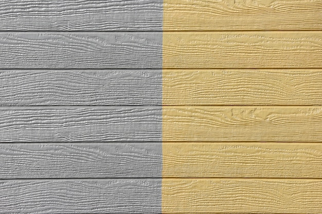 Gray yellow wood panels design wall texture background.