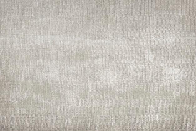 灰色がかった茶色の生地の織り目加工の背景