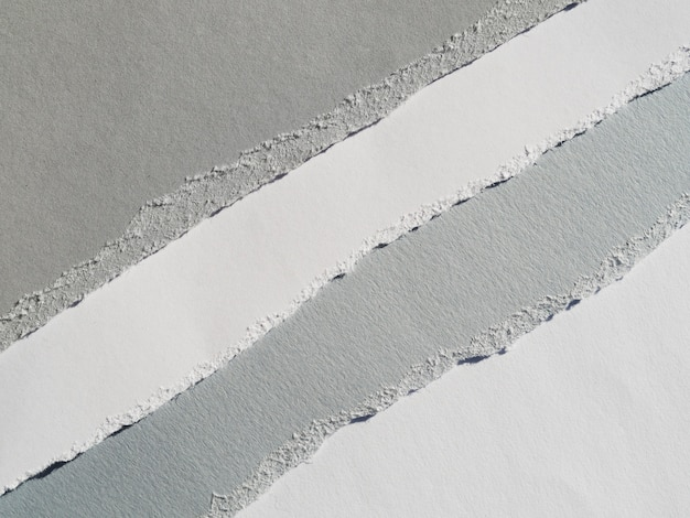 Grayscale diagonal paper rips