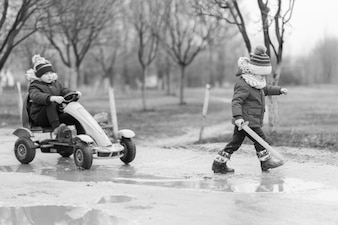 Grayscale image kids playing outside