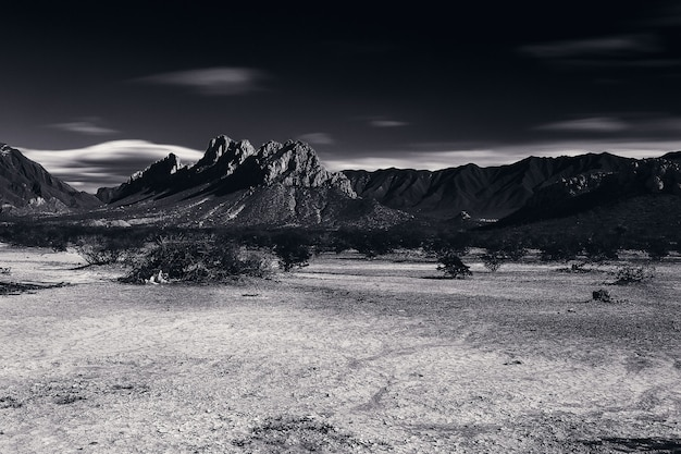 Grayscale landscape with mountains