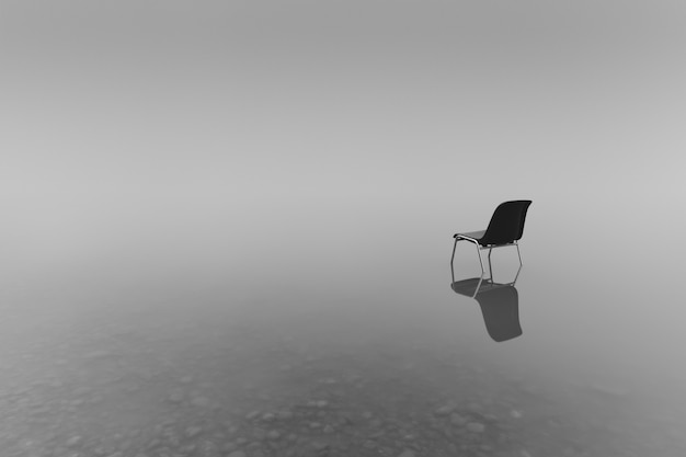 Grayscale shot of a chair on a small pond - concept of loneliness