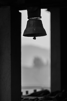 Grayscale shot of an old church bell