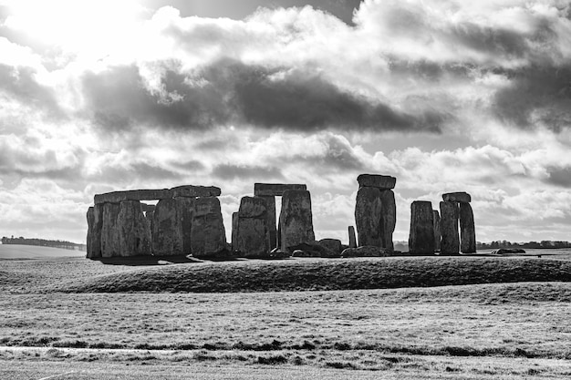 Grayscale shot of the stonehenge in england under a cloudy sky