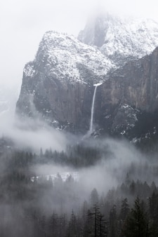 Grayscale shot of a  waterfall in yosemite national park in california