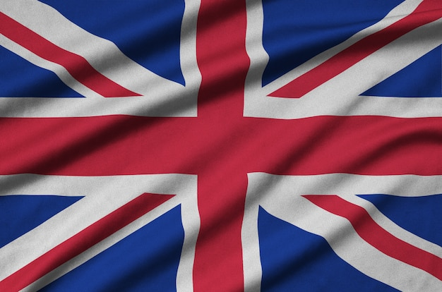 Great britain flag is depicted on a sports cloth fabric with many folds.