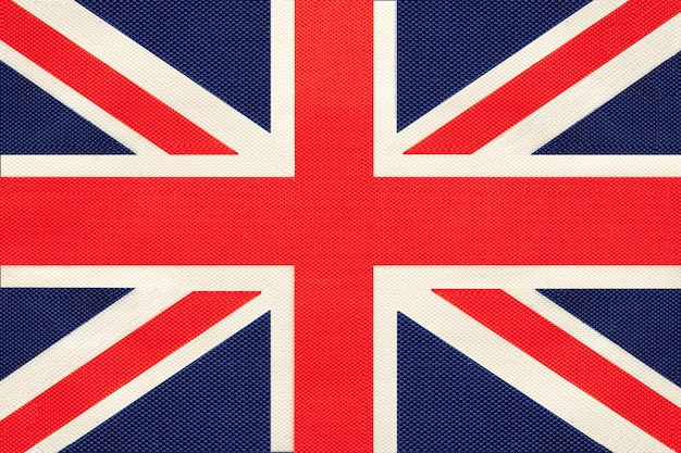 Great britain national fabric flag, textile background. symbol of united kingdom.