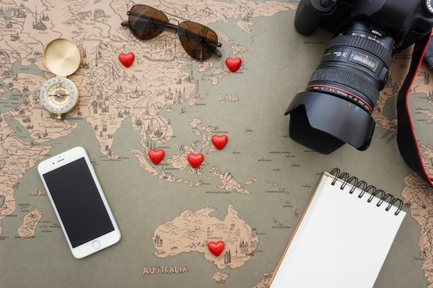 Great composition with travel objects and decorative red hearts