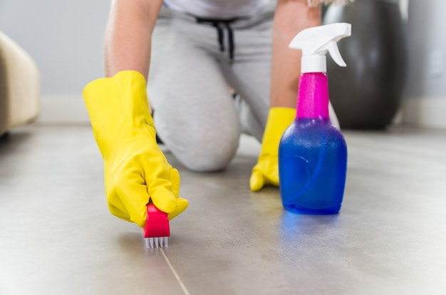 Great concept of domestic cleaning, woman cleaning the floor.