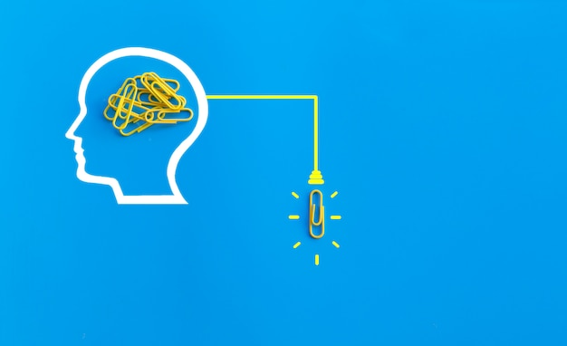 Great ideas concept with human brain, paperclip,thinking,creativity,light bulb on blue background,new ideas concept