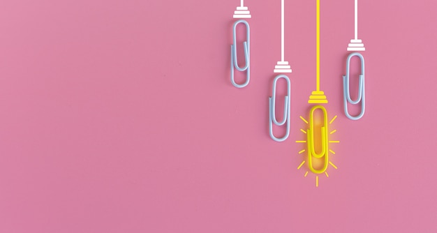 Great ideas concept with paperclip,thinking,creativity,light bulb on blue,new ideas concept.