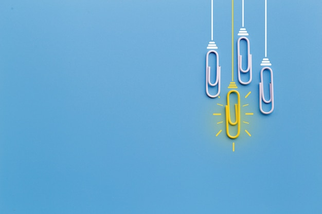 Great ideas  with paperclip,thinking,creativity,light bulb on blue background,new ideas