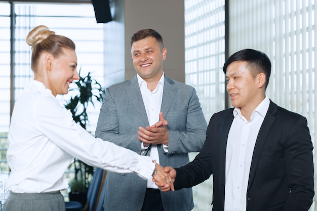 Great job! two cheerful business people shaking hands