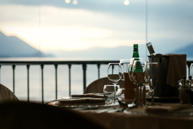 Great landscape opens behind the cosy dinner table
