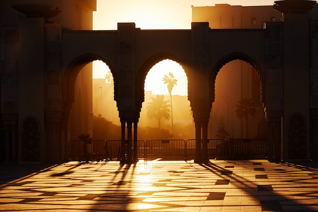 Great mosque of hassan 2 at sunset in casablanca, morocco. beautiful arches of the arab mosque