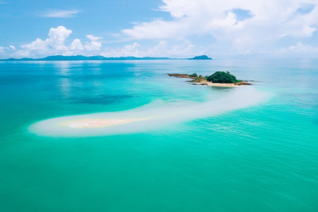 A great place to relax. a mysterious island located in the warm azure ocean. a place to relax. enjoying the warm seas. peace of mind. tourism. travel. panorama of the ocean.