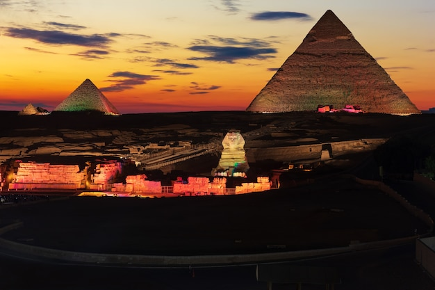 The great pyramids of giza, enlighted at night, egypt.