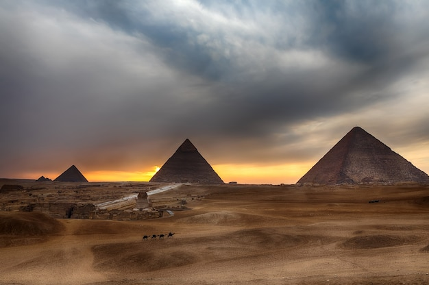 The great pyramids at sunset in giza, egypt.