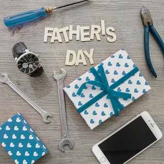 Great scene with mobile phone, gifts and tools for father's day