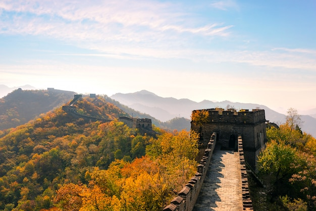 Great wall of china in colorful autumn season during sunset near beijing, china.