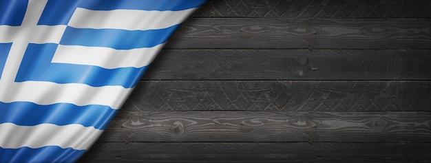 Greece flag on black wood wall. horizontal panoramic banner.