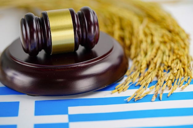 Greece flag and gavel for judge lawyer with gold grain rice from agriculture farm. law and justice court concept.