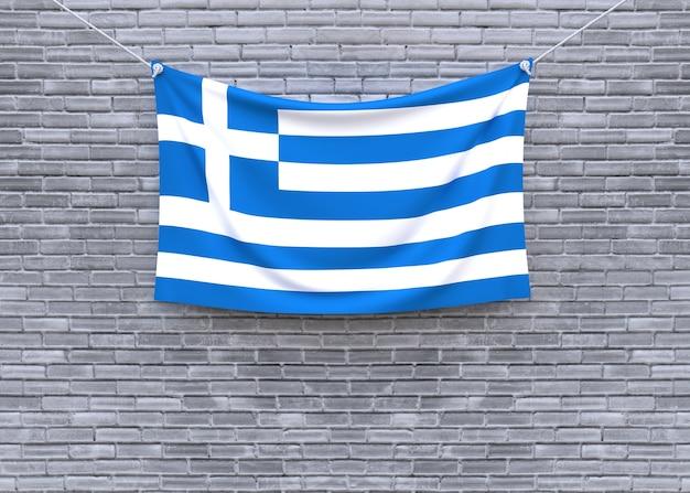 Greece flag hanging on brick wall
