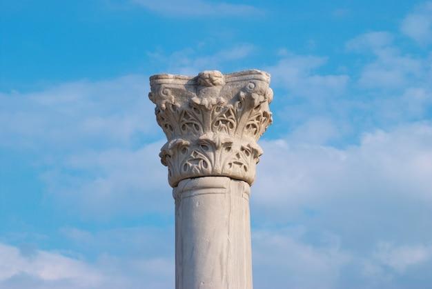 Greek column on the blue sky surface