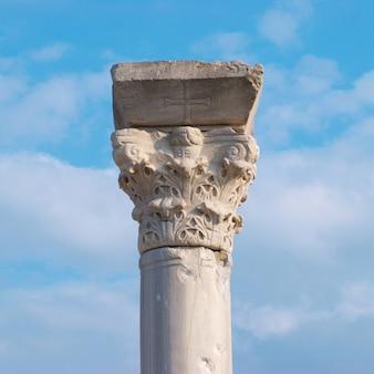 Greek column on blue sky