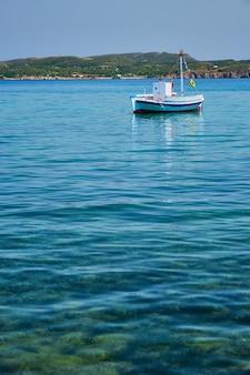Greek fishing boat in aegean sea near milos island greece