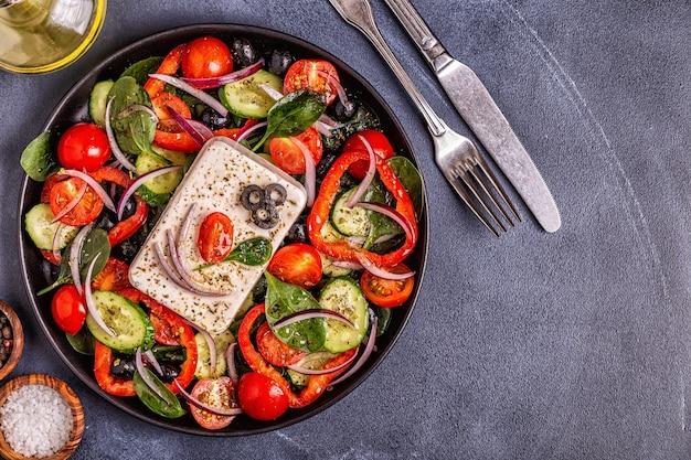 Greek salad on a black plate