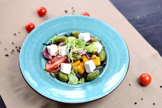 Greek salad. salad with feta cheese, olives, cherry tomatoes and bell peppers