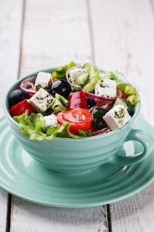 Greek salad. snack on summer parties.