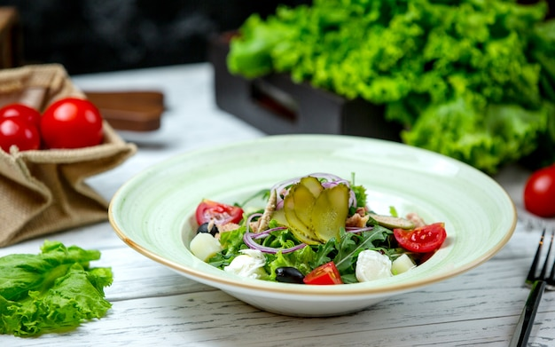 Greek salad topped with pickles