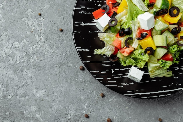 Greek salad with cucumeber, kalamata olives, feta cheese, juicy cherry tomatoes and fresh basil.