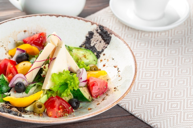 Greek salad with fresh vegetables, feta cheese close up