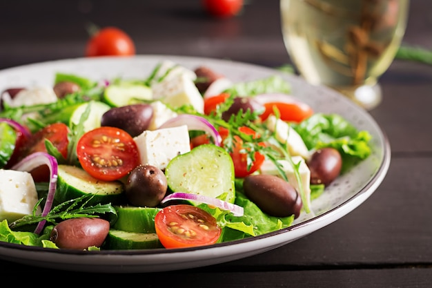 Greek salad with fresh vegetables, feta cheese and kalamata olives