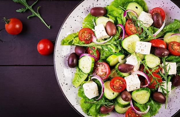 Greek salad with fresh vegetables, feta cheese and kalamata olives